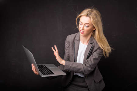 is disgusted: Woman being disgusted over something she saw on computer