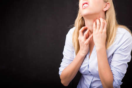 psoriasis: Woman scratching her neck Stock Photo