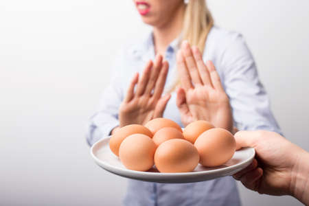 Woman refusing to eat eggs