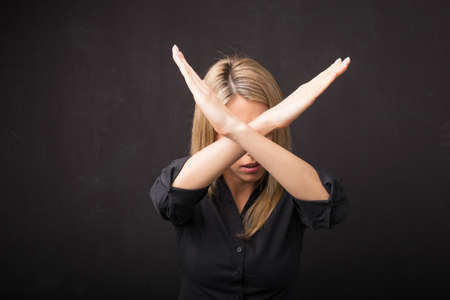 no person: Woman showing x sign with her hands Stock Photo