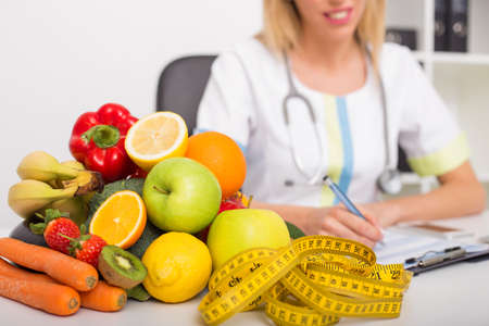 Health coach office with vegetables and tape measure