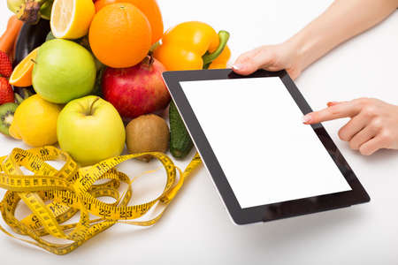 blank tablet: Tape measure, vegetables, and tablet with blank screen Stock Photo