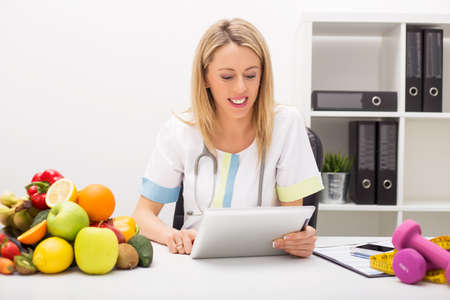 Nutrition  doctor with tablet Stock Photo