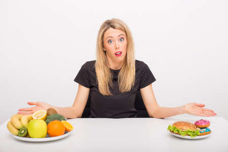 no food: Woman deciding between healthy and unhealthy lifestyle