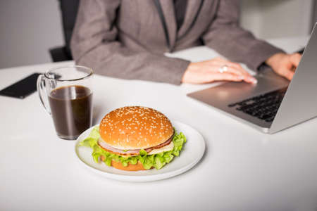 work stress: Unhealthy lunch at the office