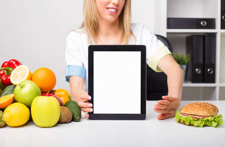 blank tablet: Health professional holding blank screen tablet
