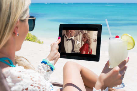 streaming: Woman watching movie on tablet computer Stock Photo
