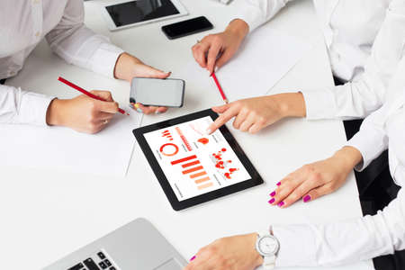 women business: Business women using tablet computer in meeting