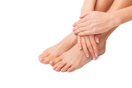 jolie pieds: Femme avec ses pieds et ses mains faites Banque d'images