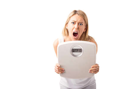 Woman holding weight scale and screaming