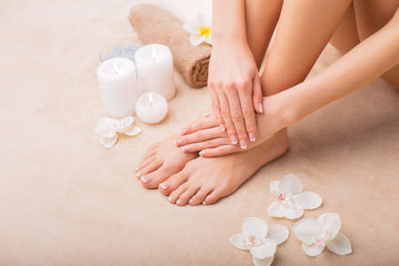 manicure and pedicure: Woman at spa with done manicure and pedicure Stock Photo