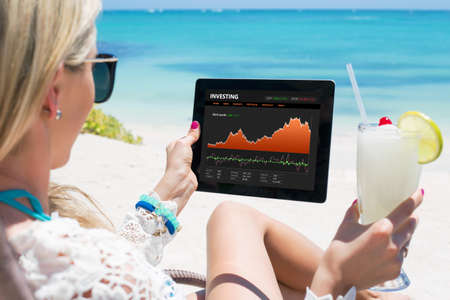 Business woman looking at graphs on digital tablet