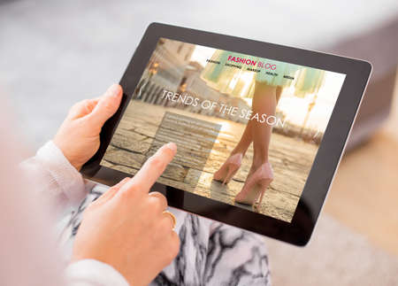 reading magazine: Fashion blog  website on digital tablet