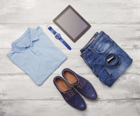 Mans clothing, watch and tablet Stock Photo
