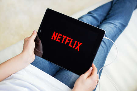 RIGA, LATVIA - FEBRUARY 17, 2016: Netflix is a global provider of streaming movies and TV series. Editorial