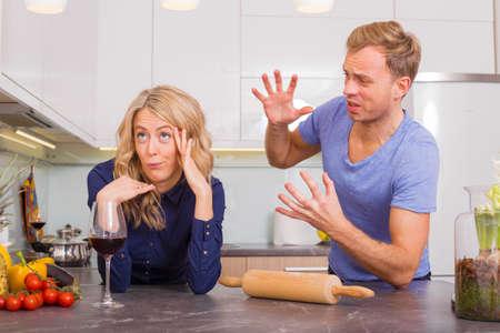 ignorant: Couple arguing in kitchen