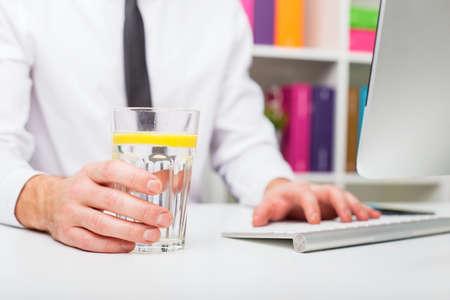 man drinking water: Man drinking water at office