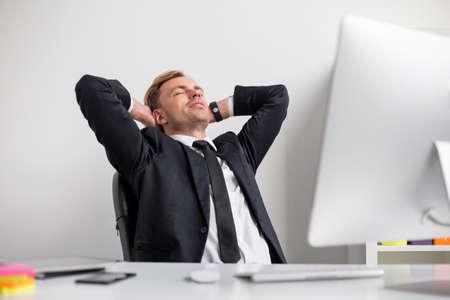 break from work: Successful business man taking break from work