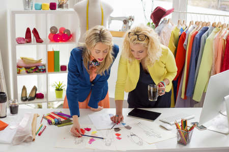 Two designers working on sketch Stock Photo