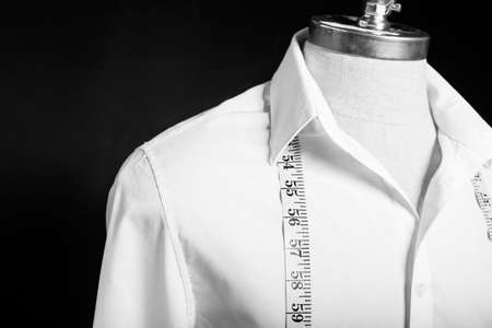 Shirt on maneken with white measurement tape Stock Photo