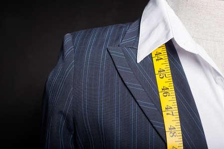tailored: Tailors maneken with measure tape Stock Photo
