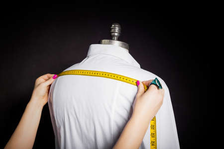made to measure: Tailor taking measurements