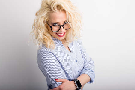 flirty: Flirty and funny woman looking over her glasses Stock Photo