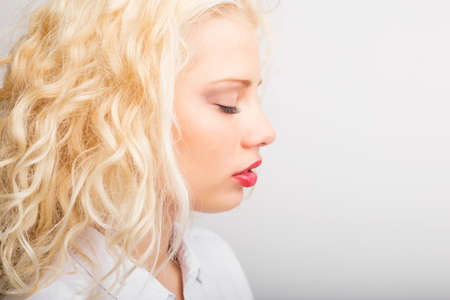 tenderness: Profile of dreamy and beautiful woman Stock Photo