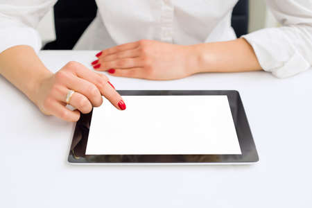 blank tablet: Woman in office using blank screen tablet Stock Photo