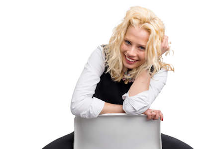 flirty: Flirty woman sitting on chair and smiling