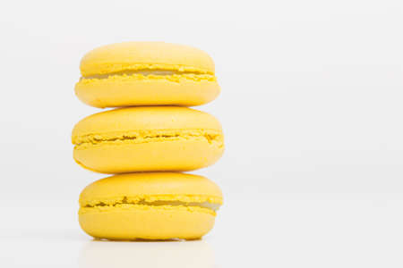 Picture of three yeallow macaroons Stock Photo