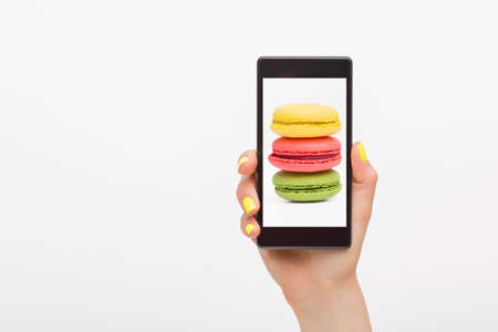 on the handphone: Picture in smartphone of macaroons