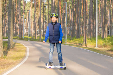 Boy in park using hoverboard