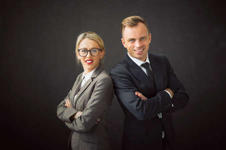 mani incrociate: Corporate business man and woman standing with their hands crossed