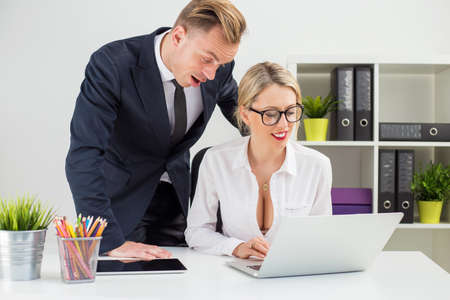 Man looking at colleagues cleavage
