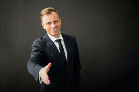 arm extended: Happy business man with extended hand Stock Photo