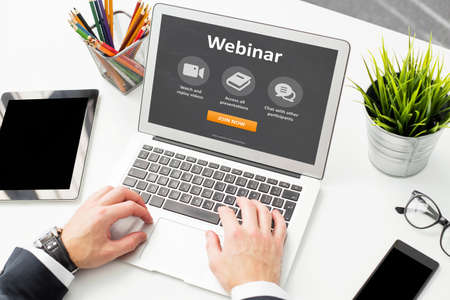 Person would join webinar on laptop Stock Photo