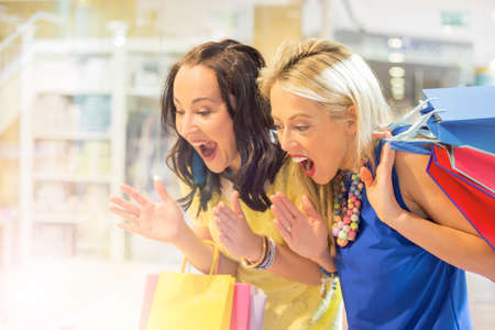 girl shoes: Excited women at the shopping center Stock Photo