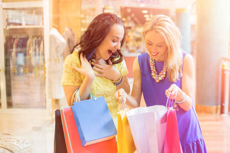 purchase: Woman showing her purchase Stock Photo