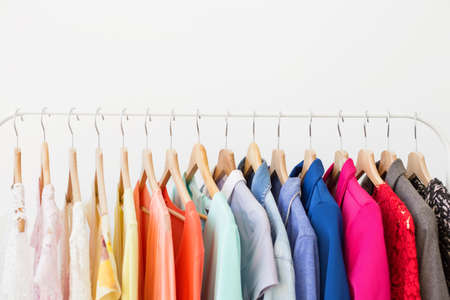 white clothes: Different clothes on the rack