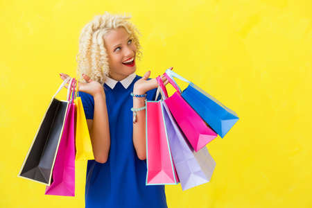 excited woman: Excited woman with shopping bags looking up Stock Photo