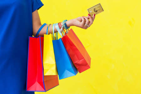 Credit card and many shopping bags