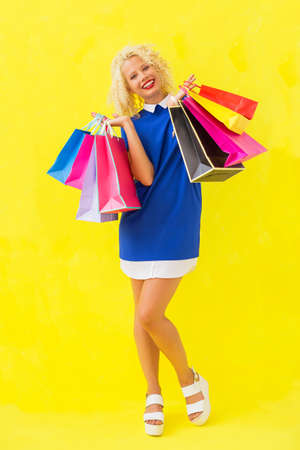after shopping: Stylish woman holding shopping baqgs after shopping Stock Photo