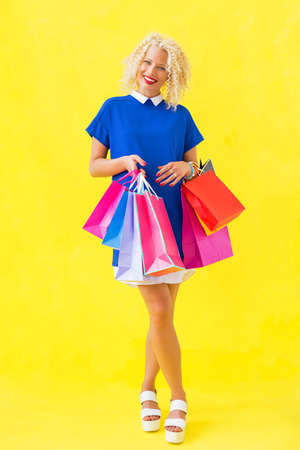 after shopping: Woman after shopping smiling Stock Photo