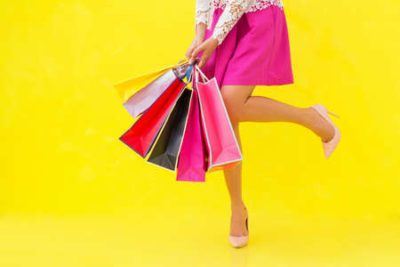 women legs: Woman with sexy legs holding shopping bags Stock Photo
