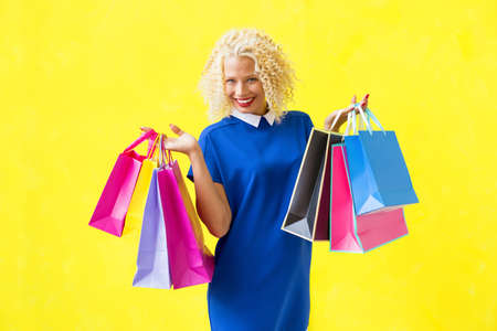 or spree: Happy woman after shopping Stock Photo