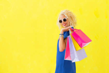 flirty: Flirty woman holding shopping bags Stock Photo