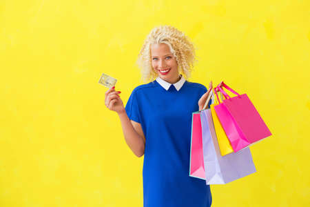 shopping card: Woman holding credit card and shopping bags Stock Photo