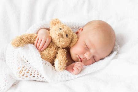 cuddled: Newborn baby sleeping
