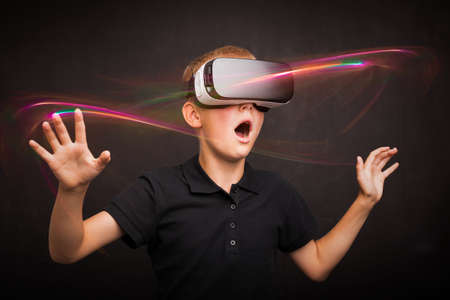 Boy experiencing virtual reality Stock Photo
